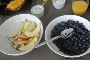 Simple Brunch Menu: egg bake, apples, blueberries, yogurt, and orange juice